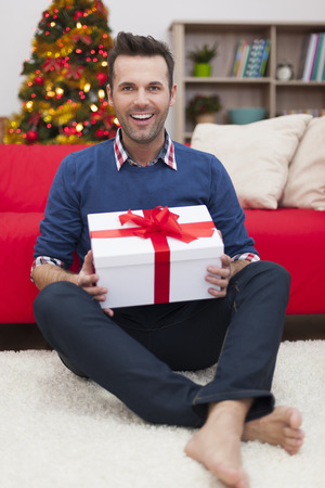 barefoot man: Portrait of handsome man with Christmas present
