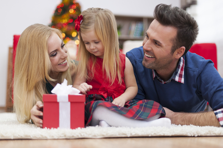 Christmas happiness of young family  photo