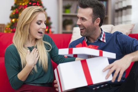 Couple opening Christmas present photo