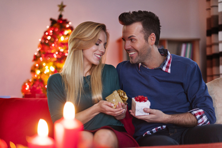 exchanging: Special moments for couple in Christmas time