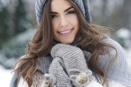 Beautiful woman loving nature during the winter   photo