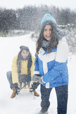 Couple have fun in snow day  photo