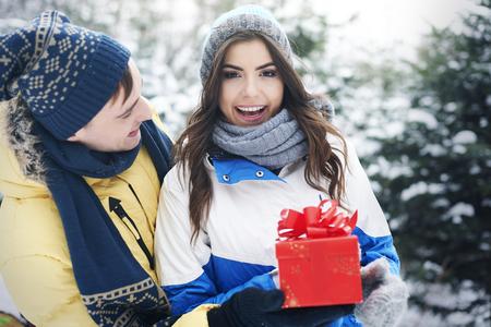 happy couple with present box photo