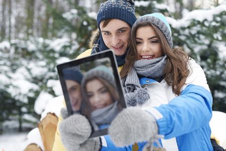 Hey baby, smile! Im taking selfie by digital tablet   photo