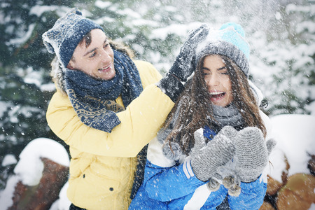 happier: Snowball fight in winter make us happier  Stock Photo