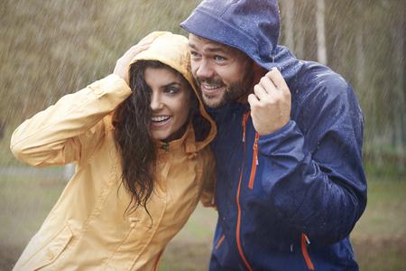 rain coat: Quick! We have to run it started to rain Stock Photo