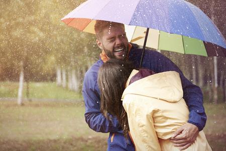 rain coat: Happy couple during rain