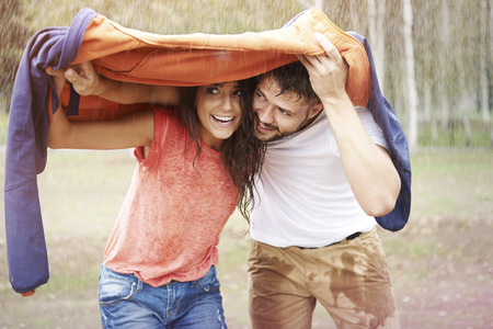 love in rain: Quick, get under my jacket!