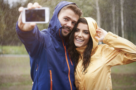 rain coat: Taking a photo during rain Stock Photo