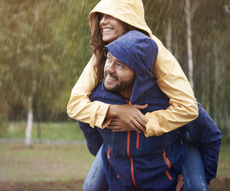 affectionate actions: In rain we are so much happy Stock Photo