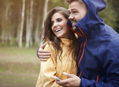 rain coat: I checked the weather on mobile phone, it shouldn Stock Photo
