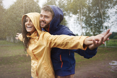 couple in rain: Feeling free in the rain