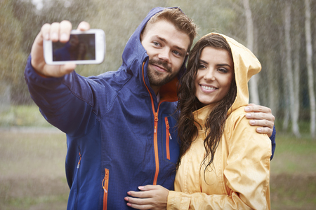 couple in rain: Selfie with my beautiful girlfriend in rainy day Stock Photo