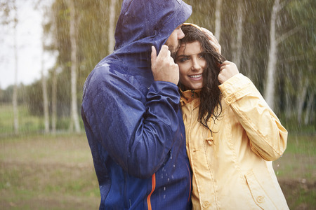 couple in rain: Big love in autumn season Stock Photo