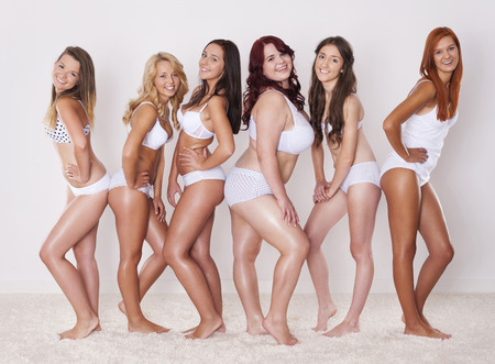 Group of happy women shows their beautiful body   Banco de Imagens