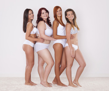 contrasts:   Group of happy women with their beautiful body