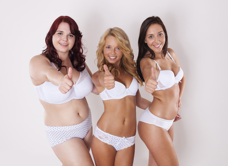 thumbs up group:  Group of happy women shows thumbs up towards camera