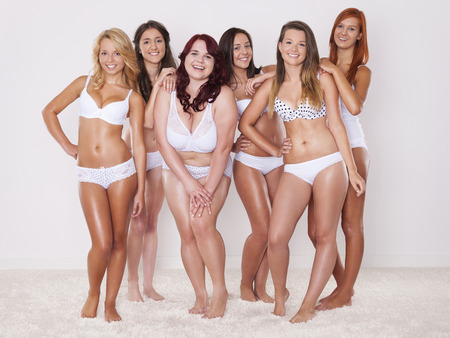 body care: Happy group of girls in underwear  Stock Photo