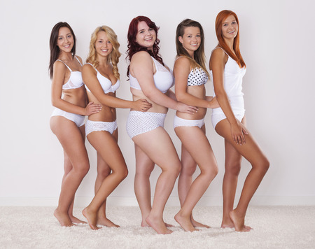 large woman: Happy group of girls in underwear