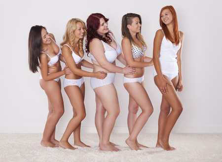 Group of happy women in underwear