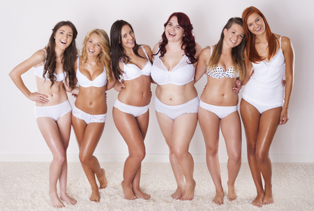 Happy women in underwear  Stock Photo