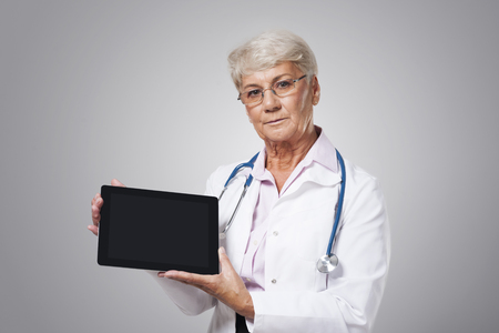 Serious female doctor with bad news photo