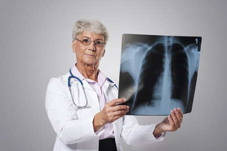 medical test: Serious senior doctor with medical test