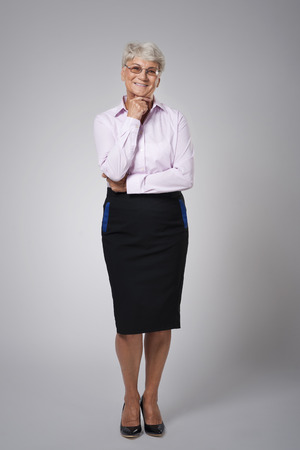 Smiling and condid senior business woman photo