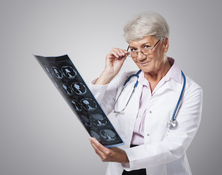 Senior doctor with x-ray image photo