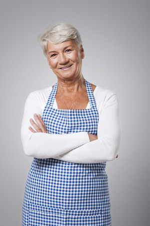 Portrait of cute grandmother wearing apron photo