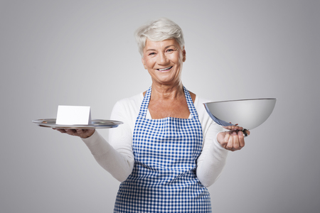 serving tray: Senior woman holding serving tray