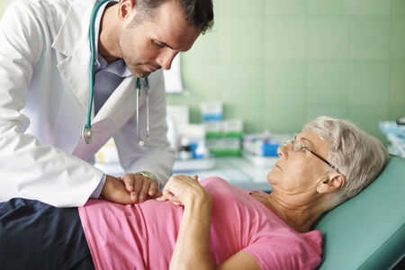on a stomach: doctor examining patient in the room