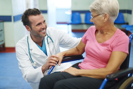 positive doctor and patient smiling Stock Photo