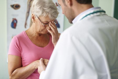 doctor stress: doctor and crying senior woman  Stock Photo