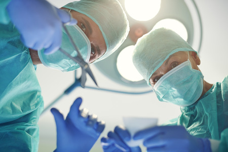 Experienced doctors during the operation photo