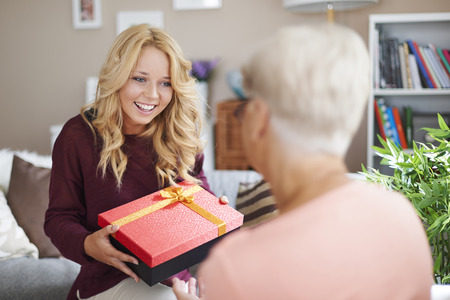 gift giving: Granddaughter gives present to her grandma