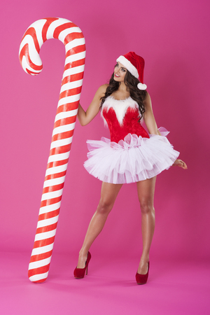 Sexy santa claus with candy cane photo