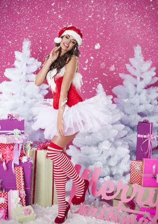 brunette woman in santa claus clothes photo