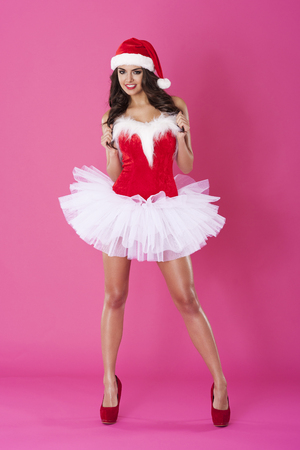 tempting: Beautiful and tempting woman in clothes of santa claus
