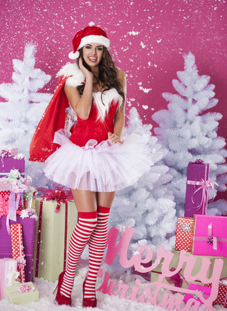 mrs  claus: Female woman in santa claus clothes enjoy during christmas Stock Photo