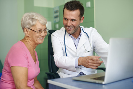 doctor appointment: Look, your results looks better Stock Photo