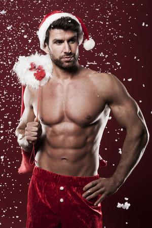 De Kerstman met kerst cadeautjes Stockfoto