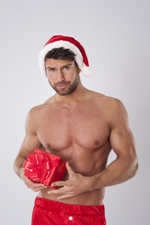 Sexy santa claus has surprise for you photo