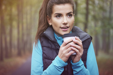 women holding cup: Hot tea is good idea for frozen day