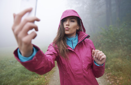 affectionate actions: Selfie during rainy day