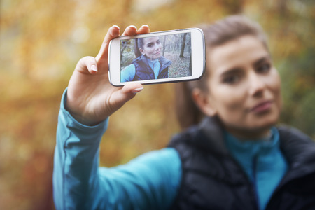 trees photography: Selfie on social network from morning jogging Stock Photo