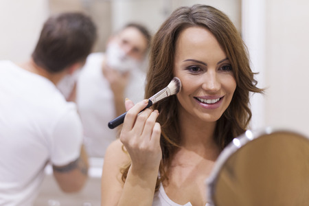 bathroom women: Morning preparing for work in bathroom
