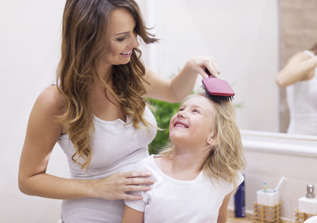 Mommy, you are the best hairdresser! Stock Photo