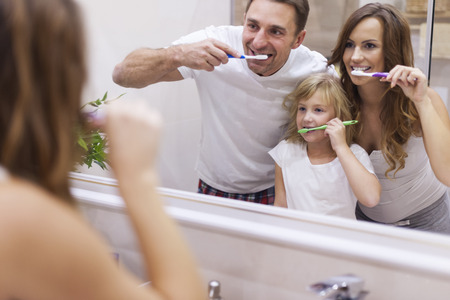 bathroom woman: Keeping your teeth in good condition Stock Photo