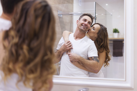 Happy couple in bathroom